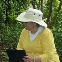 Evelyn Howell sitting outside against trees